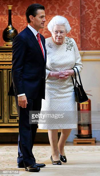 The President of Mexico Enrique Pena Nieto is shown into the Picture Gallery to view Mexican items in the Royal Collection by Queen Elizabeth II at...