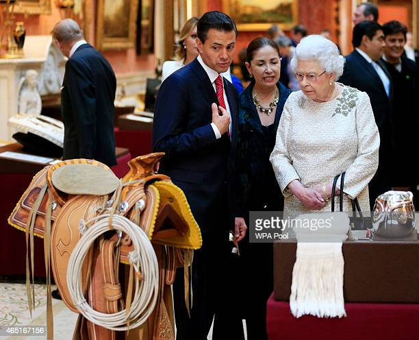 The President of Mexico Enrique Pena Nieto is shown Mexican items in the Royal Collection by Queen Elizabeth II at Buckingham Palace on March 3, 2015...