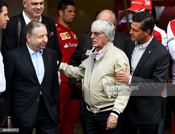 The President of Mexico Enrique Pena Nieto speaks with F1 supremo Bernie Ecclestone and President of the FIA Jean Todt outside the Ferrari garage...