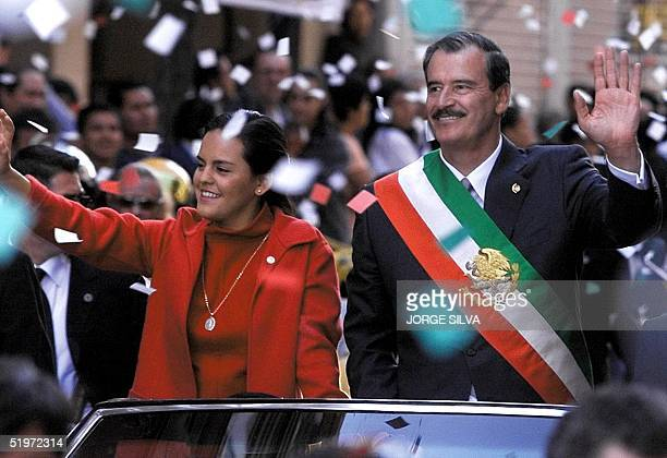 The President of Mexico Vicente Fox greets the crowd from a carl, with his wife Cristina , during the parade in front of the Presidential Palace, 01...