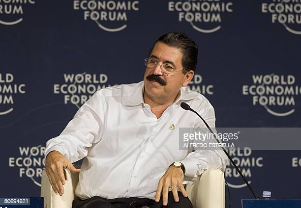 The President of Nicaragua Manuel Zelaya listens to a speech during the second day of the World Economic Forum on Latin America in Cancun Mexico on...
