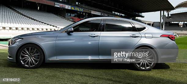 the president of OL Football Club JeanMichel Aulas is photographed with the Hyundai Genesis on april 15 2015 in Lyon France