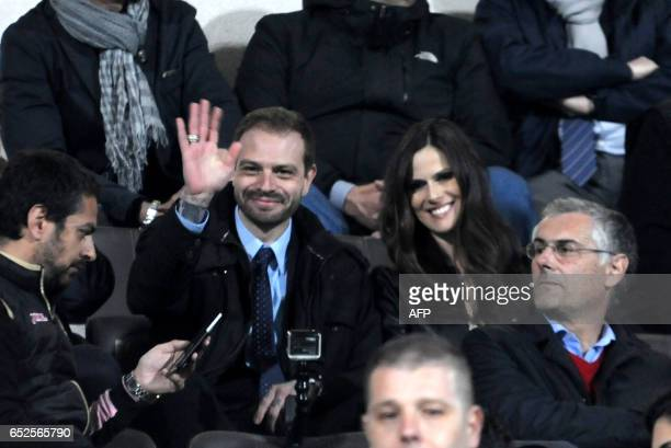 The president of Palermo's football club Paul Baccaglini and partner Thais Wiggers are seen in the stands before the Italian Serie A football match...