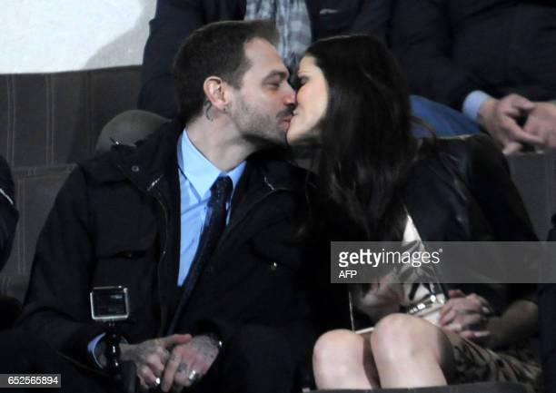 The president of Palermo's football club Paul Baccaglini kisses partner Thais Wiggers in the stands before the Italian Serie A football match Palermo...