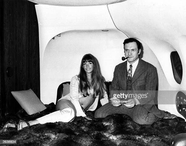 The president of Playboy Enterperises Hugh Hefner with girlfriend Barbi Benton in his luxury DC9 aircraft 'The Big Bunny' at Heathrow The couple are...