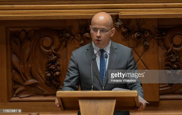 The President of Portuguese Parliament Eduardo Ferro Rodrigues listens to the new Portuguese Finance Minister João Leão as he delivers opening...