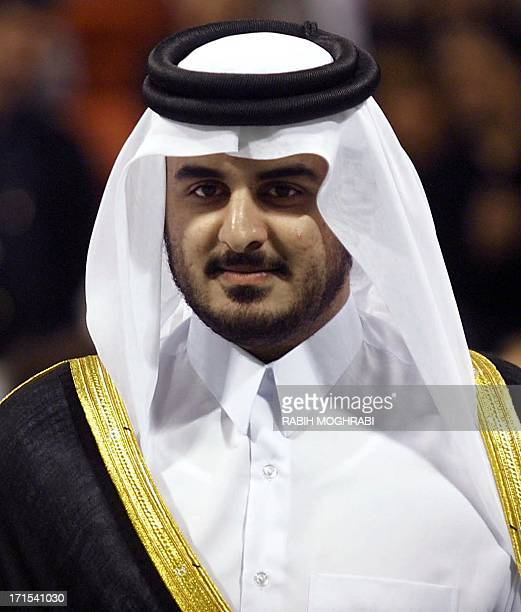 The president of Qatar's Olympic Committee Sheikh Tamim bin Hamad alThani attends the Qatar Tennis Open finals ceremony in Doha 07 January 2001 The...