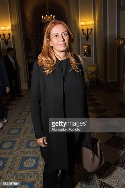 The president of RAI Monica Maggioni wearing a dark blue suit by Armani with a Birkin bag by Hermès at the Forum Ambrosetti in Villa d'Este Cernobbio...