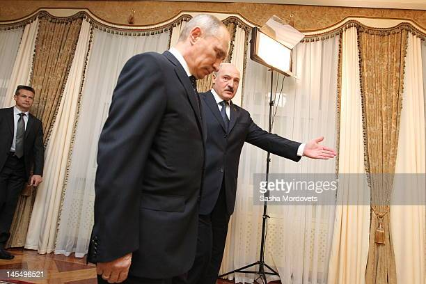 The President of Russia Vladimir Putin is greeted by the President of Belarus Alexander Lukashenko on May 31 2012 in Minsk Belarus