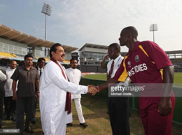 The President of Sri Lanka Mahinda Rajapaksa shakes hands with Darren Sammy captain of West Indies ahead of the Kenya v West Indies 2011 ICC World...