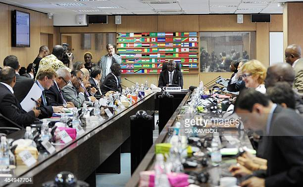 The president of the African Development Bank Donald Kaberuka attends a board meeting on September 8 2014 in Abidjan after a ceremony marking the...