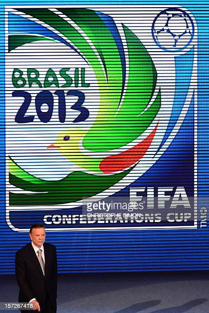 The President of the Brazilian Football Confederation Jose Maria Marin arrives on stage during the draw for next June's Confederations Cup Brazil...