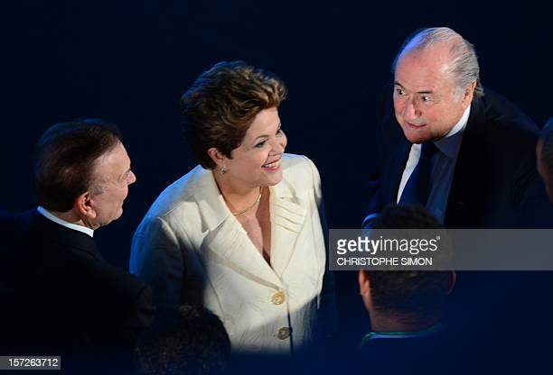 The President of the Brazilian Football Confederation Jose Maria Marin the President of Brazil Dilma Rousseff and FIFA President Joseph Blatter are...