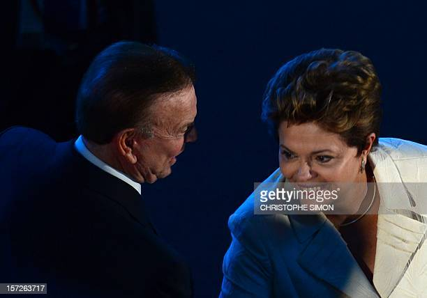 The President of the Brazilian Football Confederation Jose Maria Marin speaks to the President of Brazil Dilma Rousseff during the draw for next...