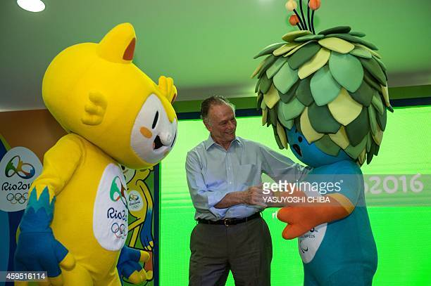 The President of the Brazilian Olympic Committee and head of the Rio 2016 Olympic Games Carlos Nuzman is pictured with the mascots for the Rio 2016...