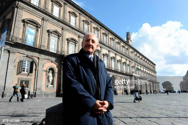The President of the Campania Region Vincenzo De Luca poses for photographer in front of Naples royal Palace