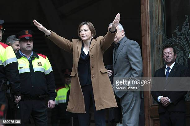 The President of the Catalan Parliament Carme Forcadell accompanied by hundreds of members of the Parliament and Mayors salutes as she walks to the...