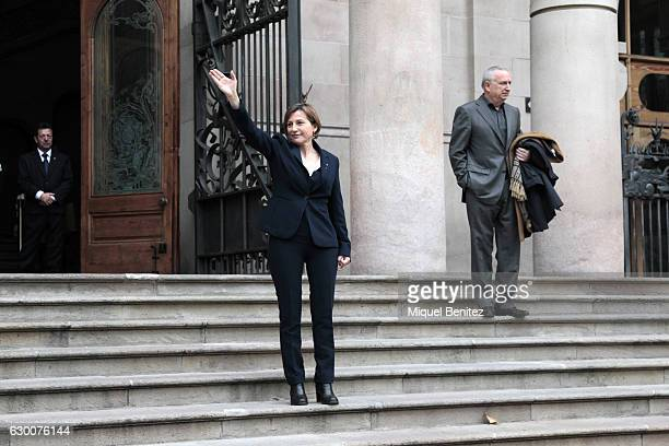 The President of the Catalan Parliament Carme Forcadell accompanied by hundreds of members of the Parliament and Mayors salutes as she leaves from...