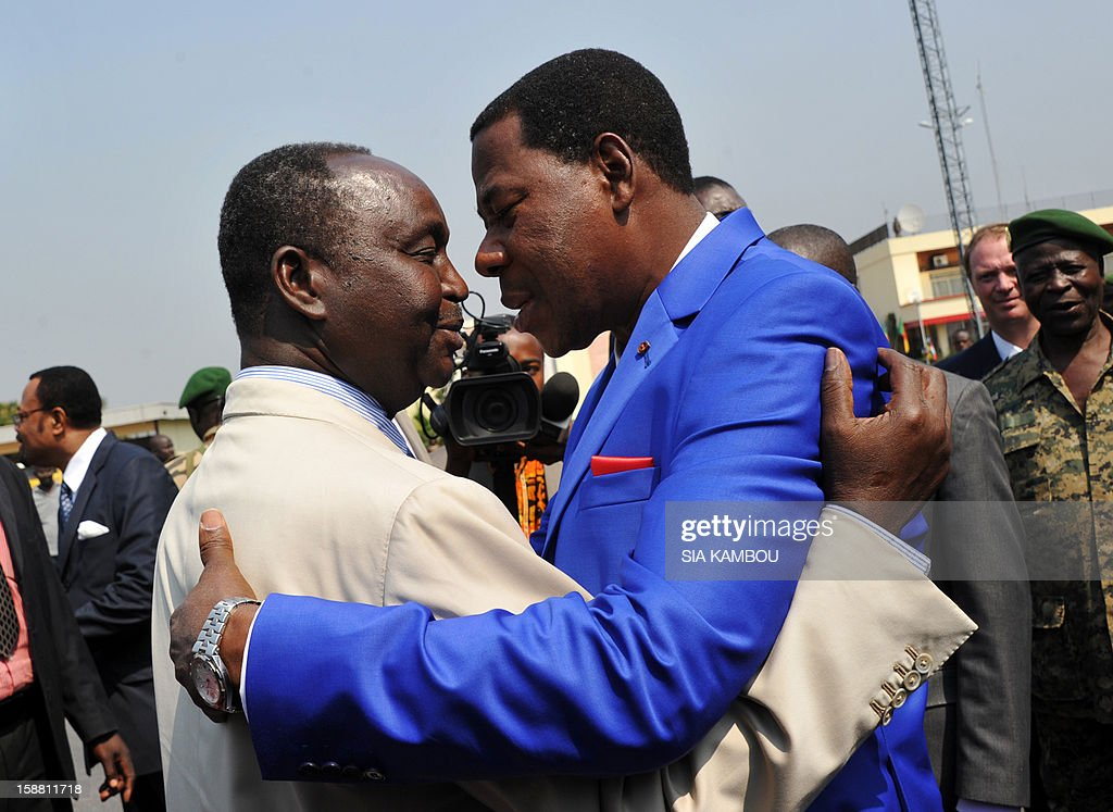 The President of the Central African Republic, Francois Bozize (L), greets the current president of the African Union and President of Benin Yayi Boni (R), after the latter arrived at the airport in Bangui on December 30, 2012, for talks over the current crisis. Rebels in the Central African Republic who have advanced towards the capital Bangui warned they could enter the city even as the head of the African Union prepared to launch peace negotiations. Central African President Francois Bozize also stated today he was open to a national unity government after talks with rebel leaders and that he would not run for president in 2016.