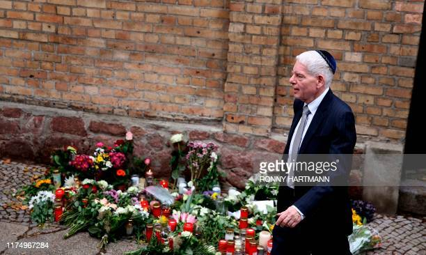 The President of the Central Council of Jews in Germany Josef Schuster leaves the synagogue in Halle, eastern Germany, on October 10 one day after...
