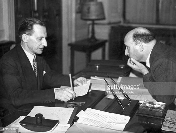 The President of the Council of Ministers of the Italian Republic Alcide De Gasperi talking to the Minister of the Interior of the Italian Republic...