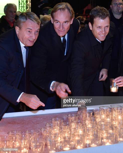 The president of the Deutsche Fussballbund , the German soccer federation, Wolfgang Niersbach , Leipzig's mayor Burkhard Jung and the manager of the...