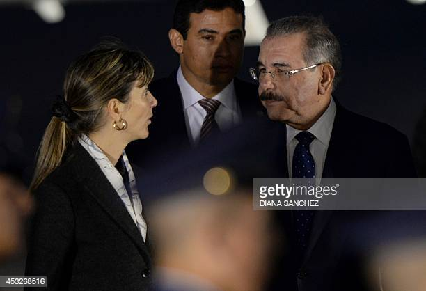The President of the Dominican Republic Danilo Medina speaks with Colombian Foreign Vice Minister Patti Londono upon arrival at the CATAM military...