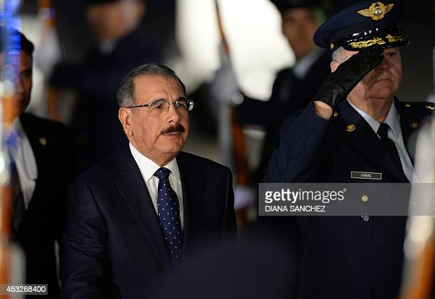 The President of the Dominican Republic Danilo Medina walks upon arrival at the CATAM military Airport in Bogota, on August 6 to attend Colombian...
