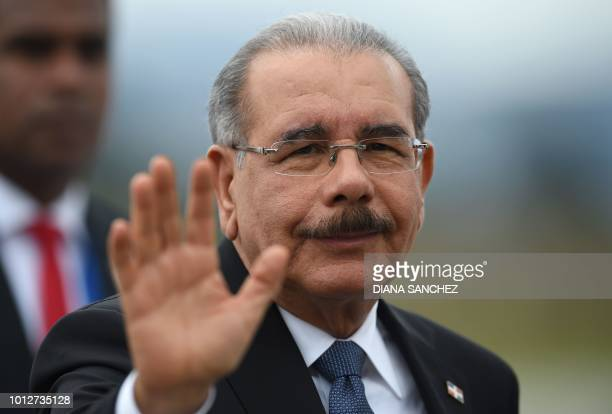 The president of the Dominican Republic Danilo Medina waves on August 7 2018 upon arriving at the CATAM military airport in Bogota where he will...