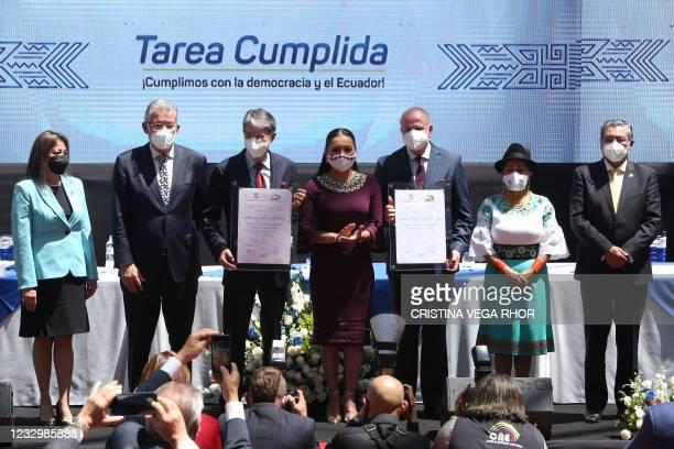 The president of the Ecuadorean National Electoral Council Diana Atamaint stands next to Ecuadorean president-elect Guillermo Lasso and his running...