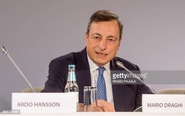The President of the European Central Bank Mario Draghi attends a press conference after the Governing Council meeting in Tallinn on June 8 2017 The...