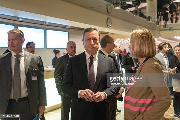 The President of the European Central Bank, Mario Draghi, talks to Christine Graeff, ECB Director General Communications, at the 25th Frankfurt...