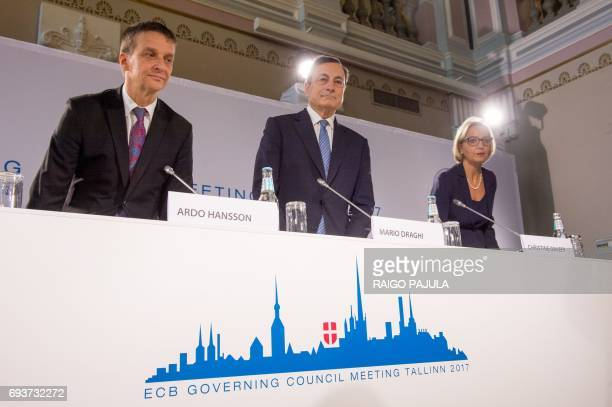 The President of the European Central Bank Mario Draghi the Governor of Bank of Estonia Ardo Hansson and ECB spokeswoman Christine Graeff arrive for...
