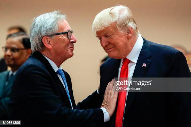 The President of the European Commission JeanClaude Juncker talks with US President Donald Trump prior to a working session during the G20 summit in...