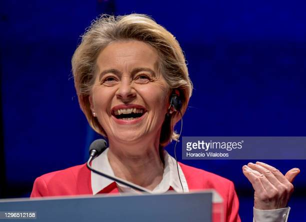 The President of the European Commission, Ursula von der Leyen laughs while delivering remarks during a joint press conference with Portuguese Prime...
