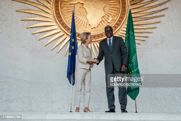 The President of the European Commission, Ursula von der Leyen shake hands with the Chairperson of the African Union, Moussa Faki Mahamat, during her...