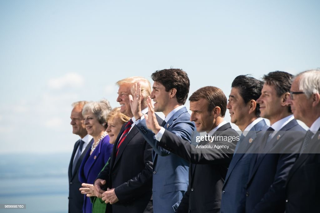The President of the European Council Donald Tusk, British Prime Minister Theresa May, German Chancellor Angela Merkel, US President Donald Trump, Canadian Prime Minister Justin Trudeau, French President Emmanuel Macron, Japanese Prime Minister Shinzo Abe, Italian Prime Minister Giuseppe Conte, and the President of the European Commission Jean-Claude Juncker pose for a family photo during the G7 Summit in La Malbaie, Quebec, Canada 08 June 2018.