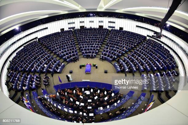 The president of the European Parlament Antonio Tajani speaks as a flag of the European Union lies draped over the coffin of former German Chancellor...
