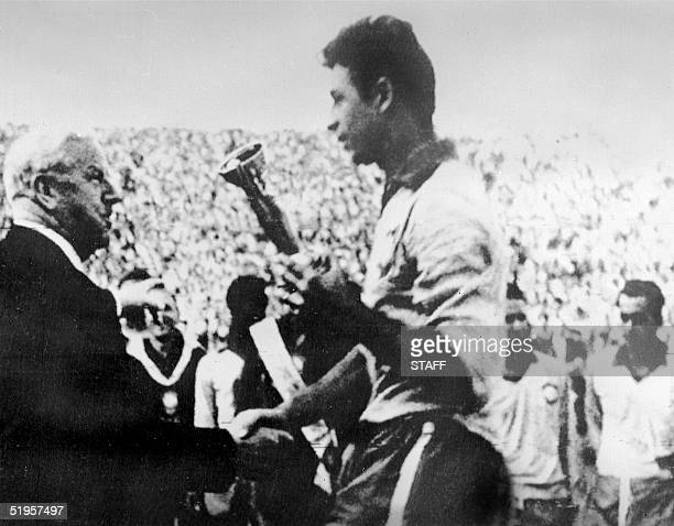 The president of the Federation Internationale de Football Association Stanley Rous from England congratulates Brazil's national soccer team captain...