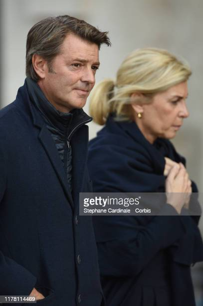 The President of the France's Mayors Organization Francois Baroin and his partner French comedian Michele Laroque arrive to attend a church service...