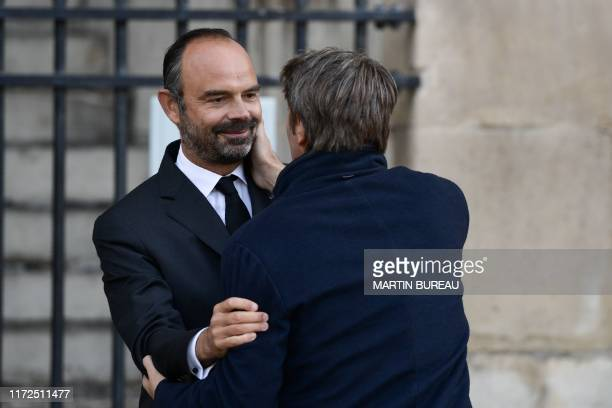 The President of the France's Mayors Organization Francois Baroin is greeted by France's Prime Minister Edouard Philippe as he arrives to attend a...