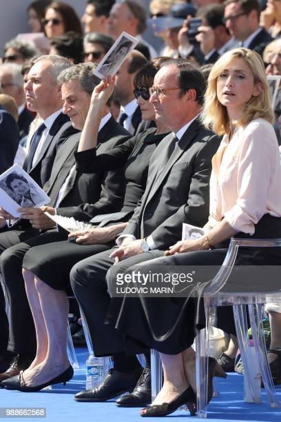 The President of the French National Assembly Francois de Rugy former French President Nicolas Sarkozy his wife musician Carla Bruni former French...