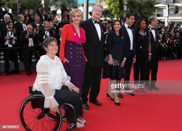 The President of the French National Olympic and Sports Committee Denis Masseglia French Sports minister Laura Flessel the copresident of the Paris...