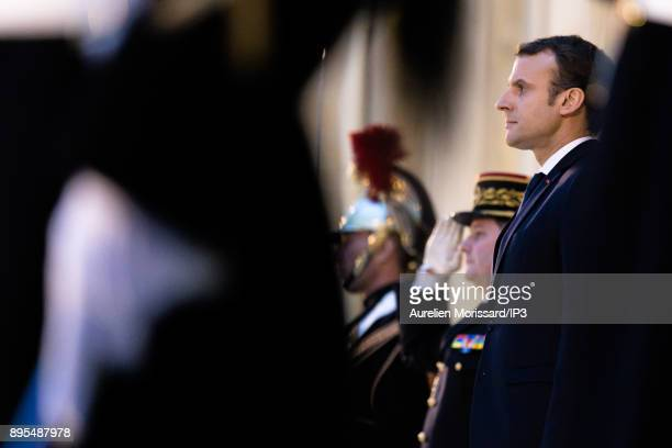 The President of the French Republic Emmanuel Macron escorts His Majesty Abdullah II King of Jordan after an interview at Elysee Palace on December...