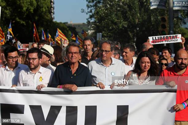the President of the Generalitat of Catalonia Quim Torra Artur Mas and Marcela Topor wife of Carles Puigdemont during the demonstration for the...