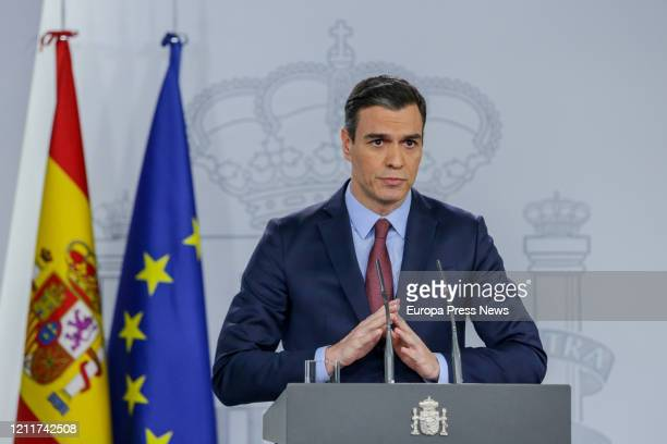 The president of the Government Pedro Sanchez is seen giving a press conference to inform and analyse the impact of Coronavirus outbreak after a...
