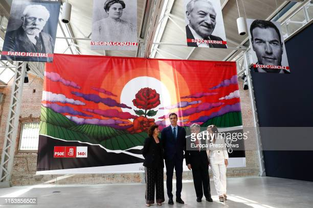 The president of the Government Pedro Sanchez is seen with the Exhibition Curator Enrique Barón the vice president of the Government Carmen Calvo and...