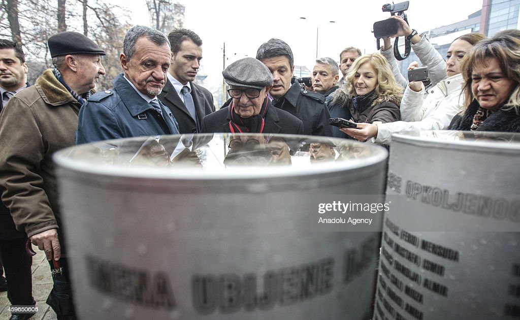 The President of the International Criminal Tribunal for the former Yugoslavia (ICTY) Theodor Meron (C) visits the monument which built in commemoration of murdered children during the Sarajevo besieged, in Konjic, Bosnia and Herzegovina, on November 27, 2014.