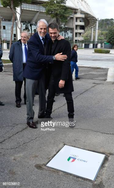 The president of the Italian Olympic Committee Giovanni Malago welcomes former player Paolo Maldini during the ceremony Walk of Fame in Rome Italy on...