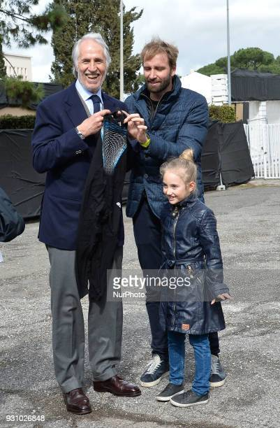 The president of the Italian Olympic Committee Giovanni Malago poses with the swimmer Massimiliano Rosolino during the ceremony Walk of Fame in Rome...